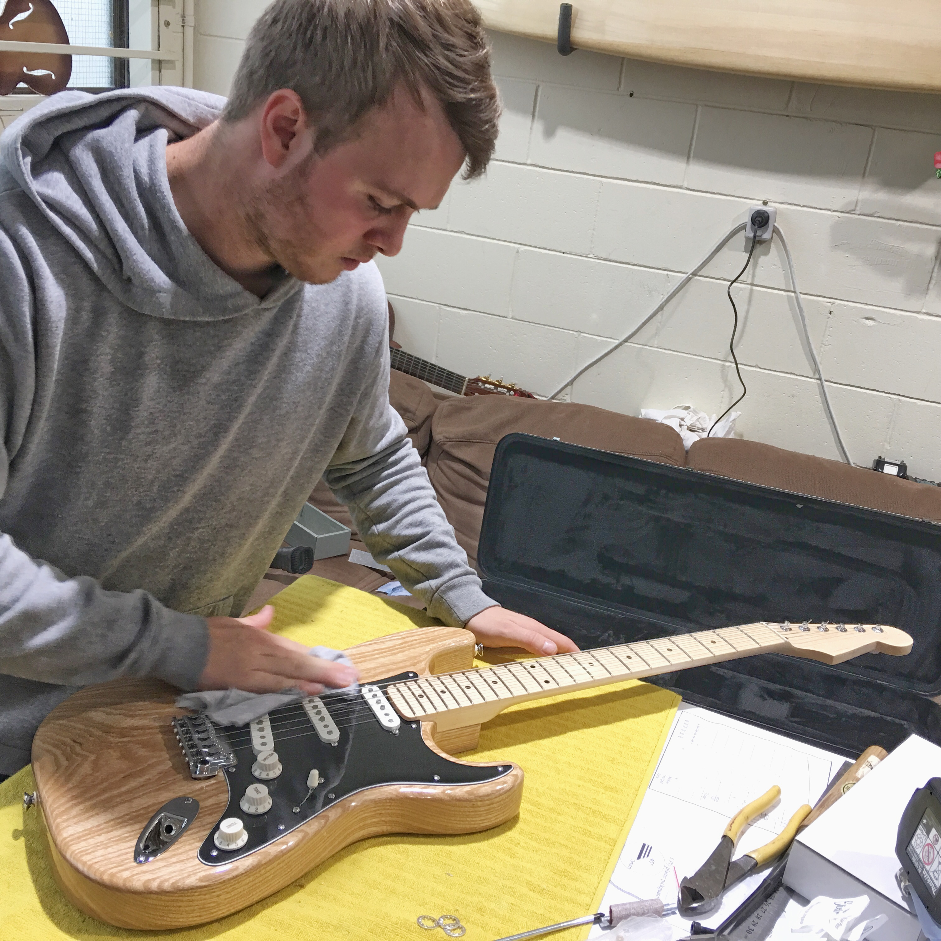 Jamie with his Strat-style electric guitar